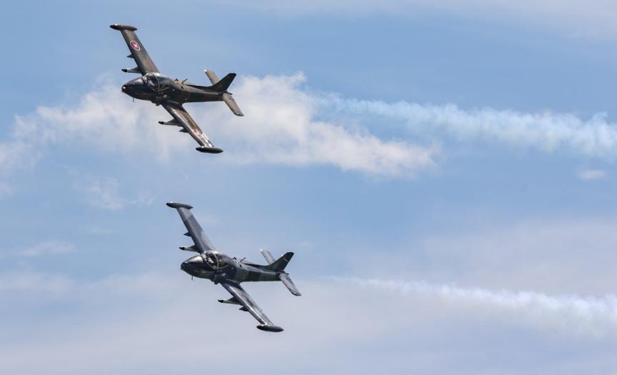 Strikemaster Pair in formation with smoke