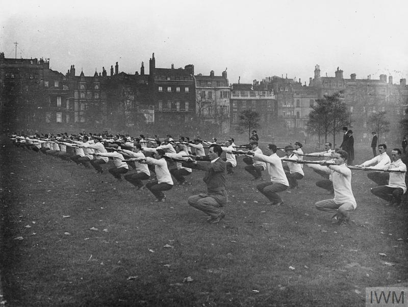 Troops of the 1st Battalion, County of London Volunteers (United Arts Volunteer Rifles) at physical exercise and rifle drill. Green Park, October-November 1914.