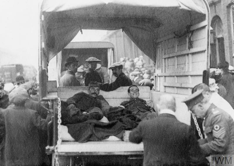 Wounded British soldiers arrive in the back of delivery vans at West Ham and Eastern General Hospital, October 1914.