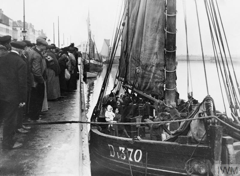 Families of Belgian refugees prepare to leave Ostend in a trawler, 16 October 1914.