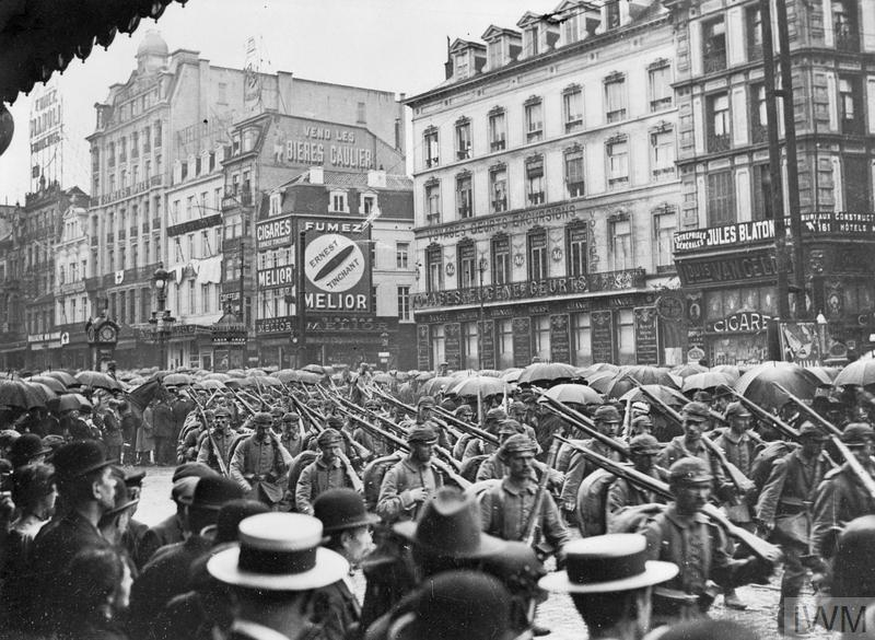 German infantry crossing the Place Charles Rogier in Brussels as civilians look on following the invasion of Belgium, August 1914.