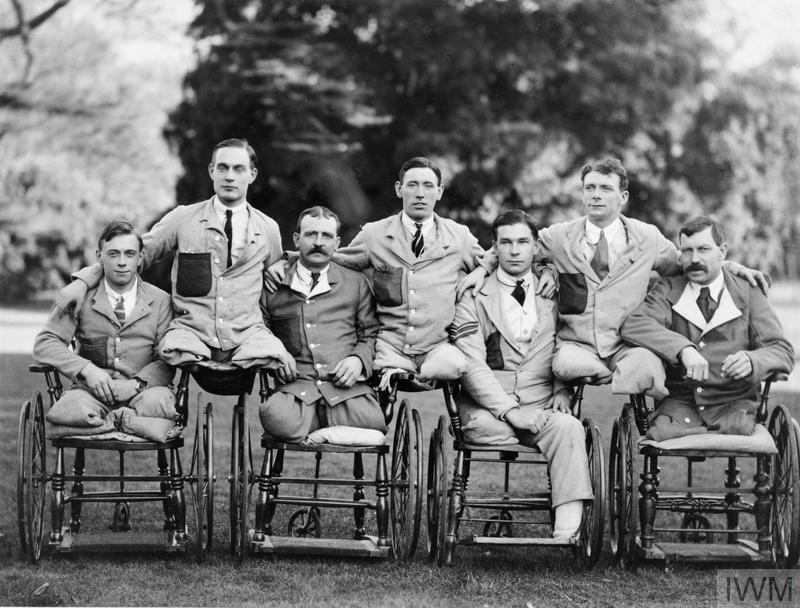 "Servicemen with missing limbs in wheelchairs at Roehampton Military Hospital. Note the soldiers are wearing ""Hospital Blues""."