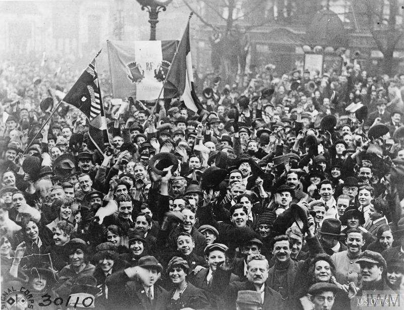 Cheering crowds on the Boulevard in Paris, 11 November 1918.