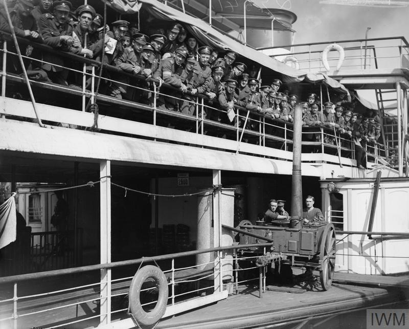 Demobilised men on the Rhine steamer which took them to Rotterdam on their way to England. Note field kitchen in foreground in which the meals were cooked. Cologne, 23 April 1919.