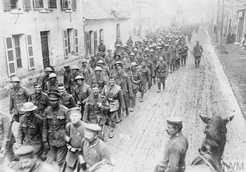A long column of the first batch of British prisoners captured in the German breakthrough at St. Quentin arriving at a village south of St. Quentin, March 1918.