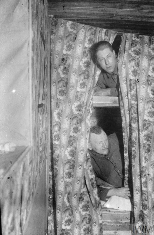 Two German soldiers in curtained-off bunkbeds. The top soldier is Herbert Sulzbach. The entire collection probably depicts the service of the German 5th Field Artillery Regiment von Podbielski (1st Lower Silesian) - Feldartillerie-Regiment von Podbielski (1. Niederschlesisches) Nr. 5.