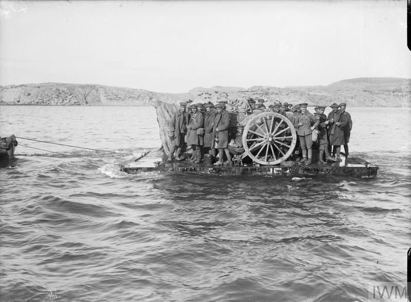 Evacuating guns and personnel from Suvla Point on rafts in daylight in December 1915.
