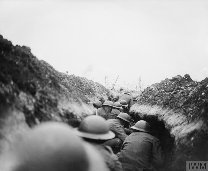 A raiding party of the 10th Battalion, Cameronians (Scottish Rifles) waiting in nap for the signal to go. John Warwick Brooke, the official photographer, followed them in the sap, into which a shell fell short killing seven men. Near Arras, 24 March 1917.