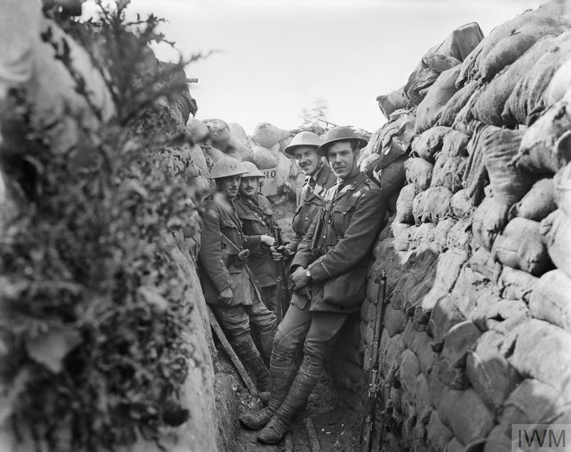 Battle of Albert. Officers of the Royal Engineers in a communication trench. Rearmost officer wearing Other Ranks tunic. Unidentified headquarters sign in background. 1st July 1916.