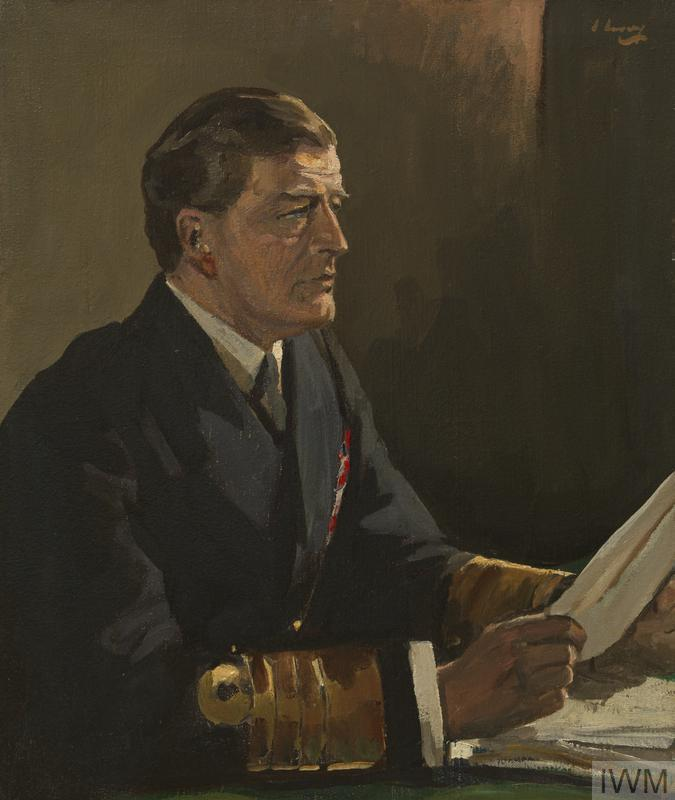 A half-length portrait of Admiral Sir David Beatty in full uniform seated at a desk reading a paper he holds in his hands.