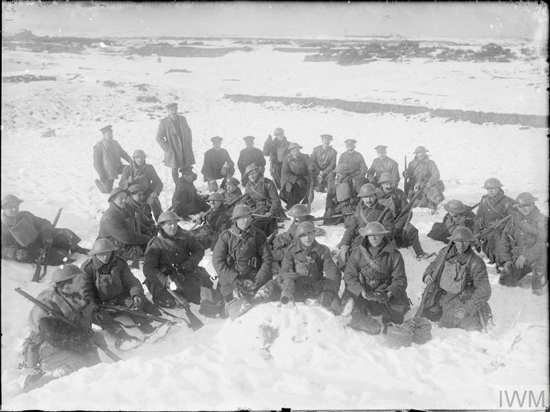 Group of British troops, possibly Rifle Brigade, pose in the snow with a Lewis machine gun at Beaumont Hamel, early 1917.