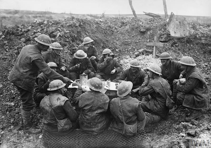 British troops eating their Christmas dinner in a shell hole, Beaumont Hamel, 25th December 1916.