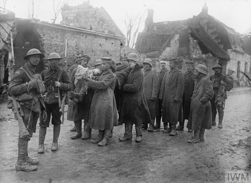 Battle of the Scarpe. German prisoners carrying one of their wounded at Arras, April 1917.