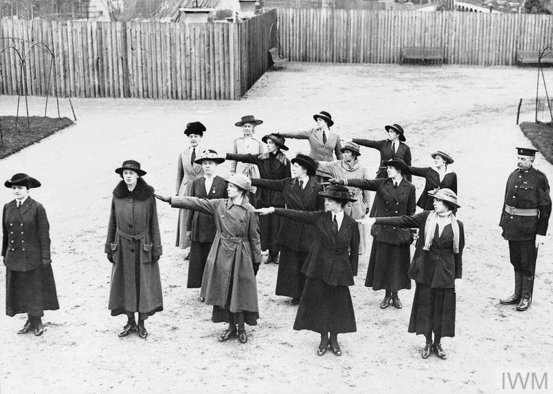 New officer recruits to the Women's Royal Naval Service (WRNS), wearing a mix of civilian dress and uniform, undergo a squad drill at Crystal Palace.