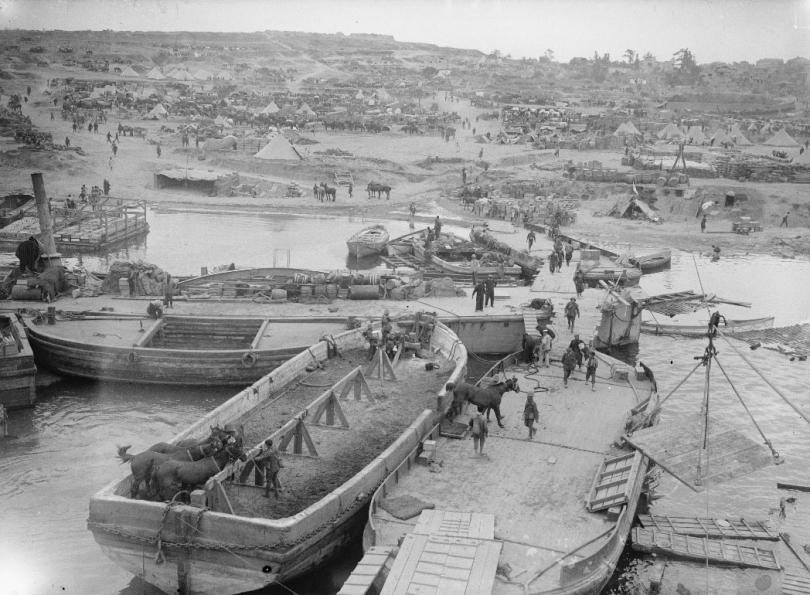 A view of 'V' Beach, Cape Helles, Gallipoli, taken from SS RIVER CLYDE. Horses are disembarked from the nearest lighter.