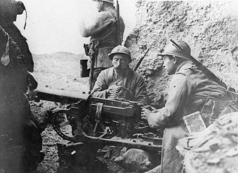 French troops manning a captured German Maxim MG 08 machine gun (mounted on a sledge) at Fort Douaumont, Verdun.
