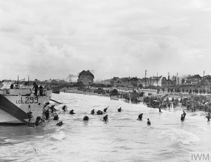 Troops of 9th Canadian Infantry Brigade disembarking with bicycles onto Juno Beach