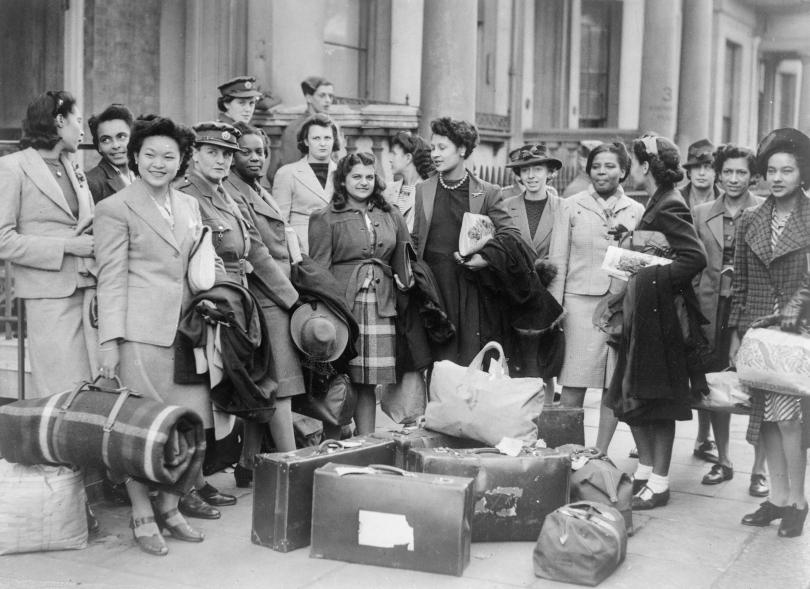 group of West Indian women recruited to join the ATS, wait for transport to take them to their training camp, 10 November 1943.