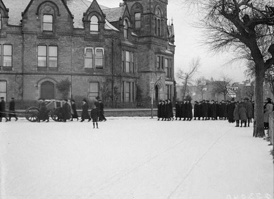 Funeral Procession of Assistant Principal Evelyn Mackintosh, W. R, N. S. passing Naval Depot, Inverness Base, 24th December 1918