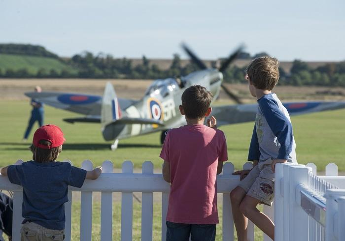 Children looking at a Spitfire at Duxford Air Shows