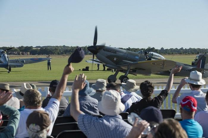 Crowd wave to a Spitfire pilot at Duxford Air Shows
