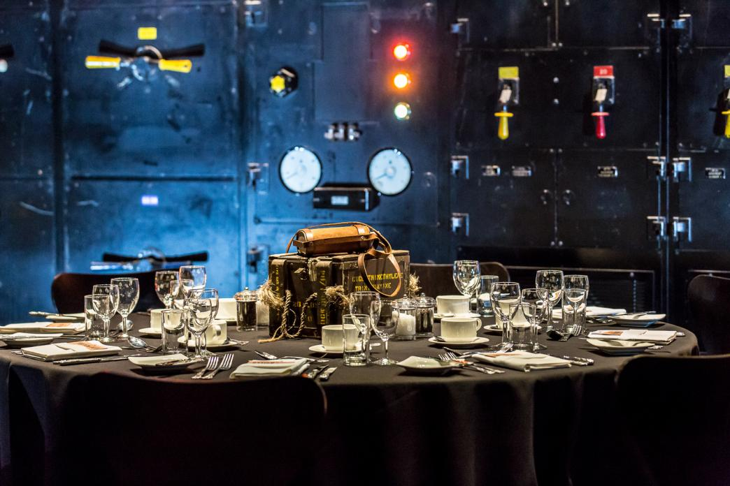 Interior of the Harmsworth Room at Churchill War Rooms set up for an event, tables laid. imperial War Museums