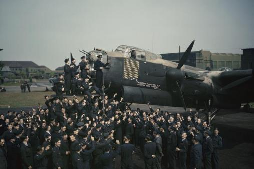 Aircrew and ground staff of No. 467 Squadron, RAAF, celebrate the completion of 100 operations by the Avro Lancaster R5868 'S for Sugar', May 1944.