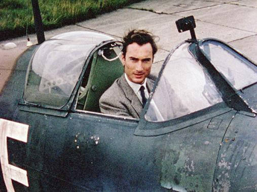 Prince William of Gloucester sits in Spitfire at Battle of Britain film set, RAF Duxford