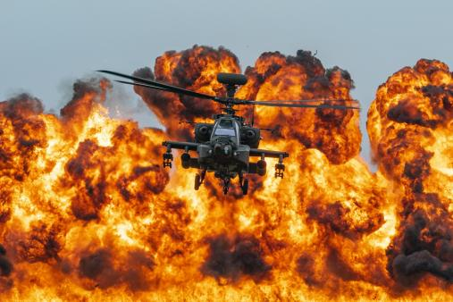 Apache with wall of fire behind at Duxford Air Shows