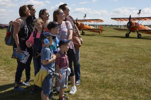Family enjoying the Flightline Walk at Duxford Air Festival