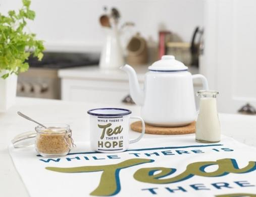 Homeware products from the Imperial War Museums shops including a mug that reads While There's Tea There Is Hope