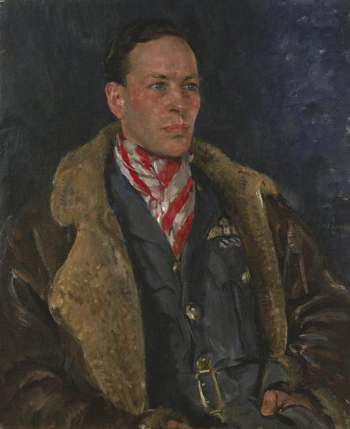 Seated portrait of Squadron Leader G L Denholm in uniform wearing a flying jacket and a red and white striped cravat.
