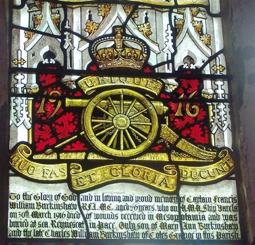 Stained glass window featuring the Royal Artillery regimental badge.