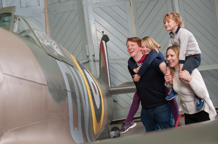 Family enjoying a Supermarine Spitfire
