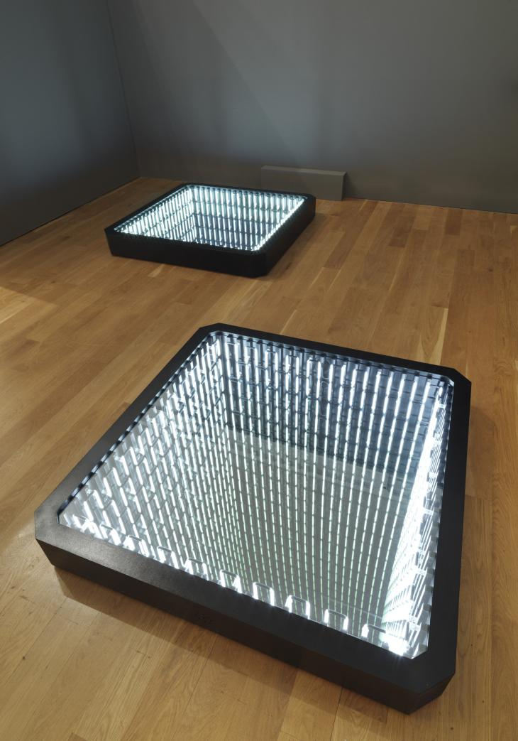 Artwork in gallery space of mirrored squares