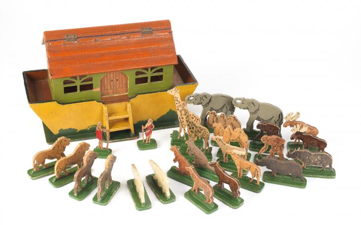 A handmade Noah's Ark toy made from wooden cigar boxes and bag straps