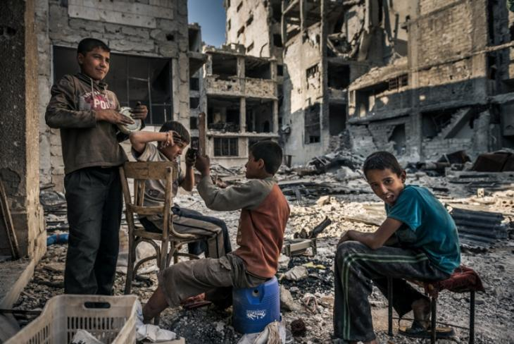 Homeless children play in the ruins of Homs after Opposition forces left the area.