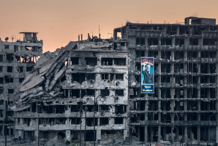 An election campaign poster for President Bashar al-Assad displayed on a ruined shopping mall in the Khalidiya district of Homs