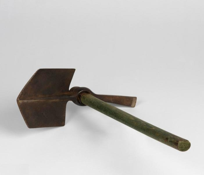 An entrenching tool head and helve.