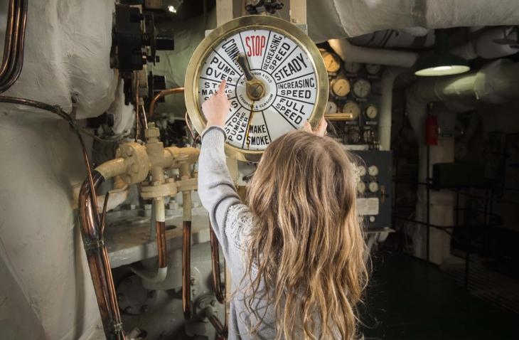 Girl in engine rooms of HMS Belfast