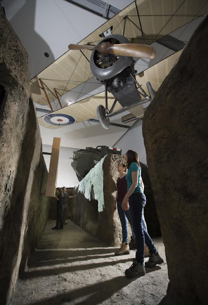 Visitors walking through the recreated trench experience in the First World War Galleries