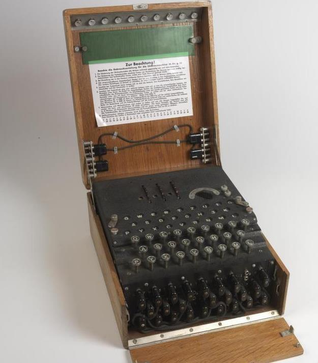 The 'Enigma': A three-rotor German Enigma enciphering machine, built into a wooden case.