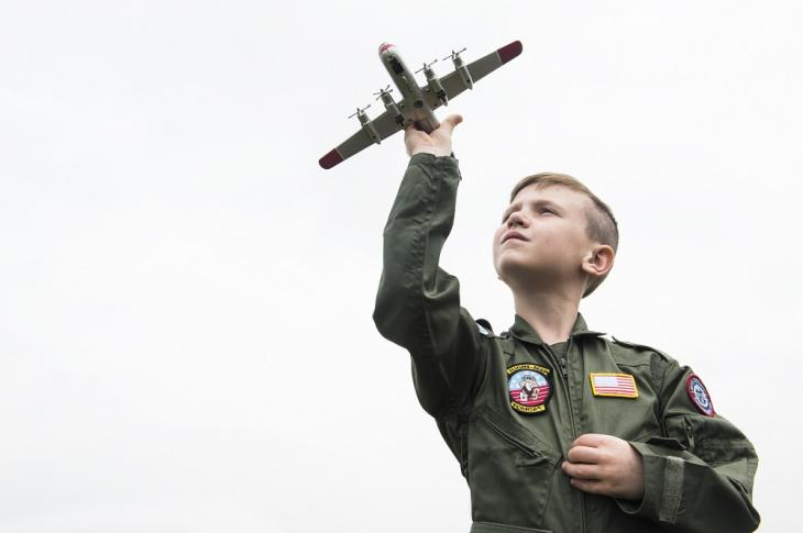 Boy with toy aircraft at Duxford Meet the Fighters 2016