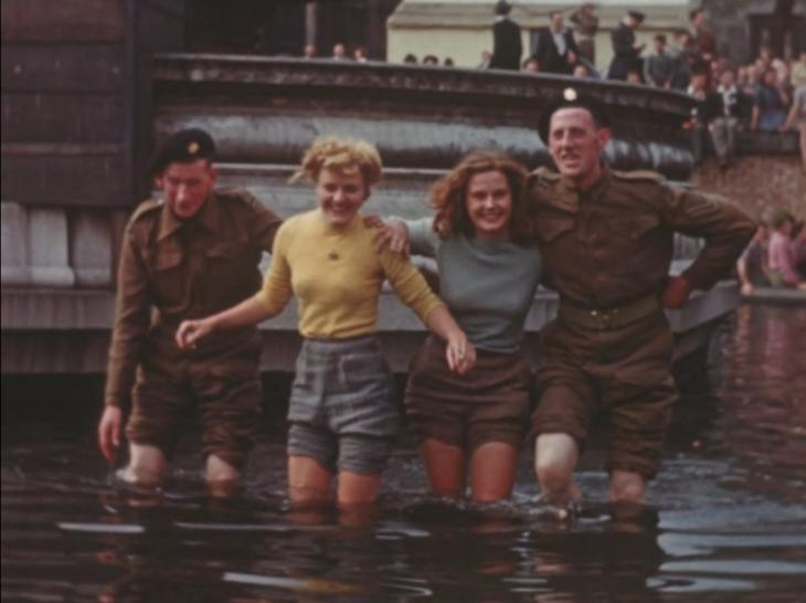 Joyce and Cynthia wading in one of the fountains in Trafalgar Square, 8 May 1945.