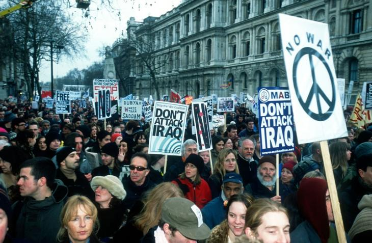 Protesters march along Whitehall in London, 15 February 2003.