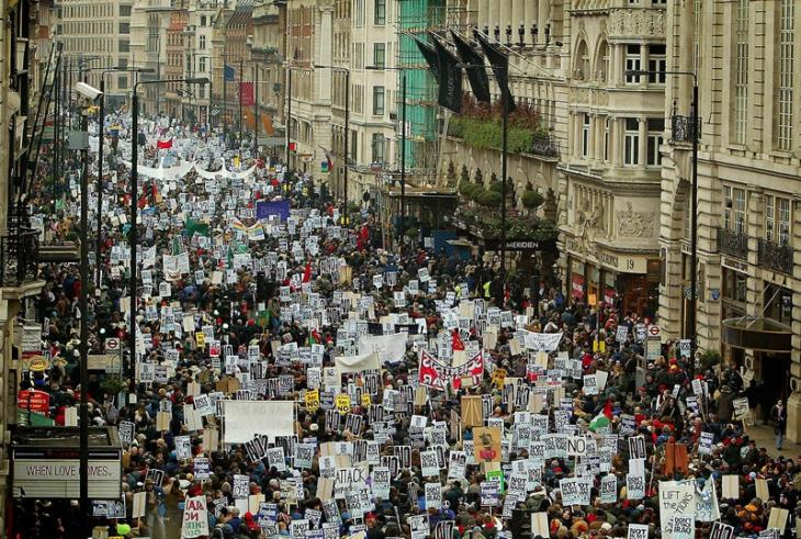Anti-war protesters march along Piccadilly in London, 15 February 15, 2003.