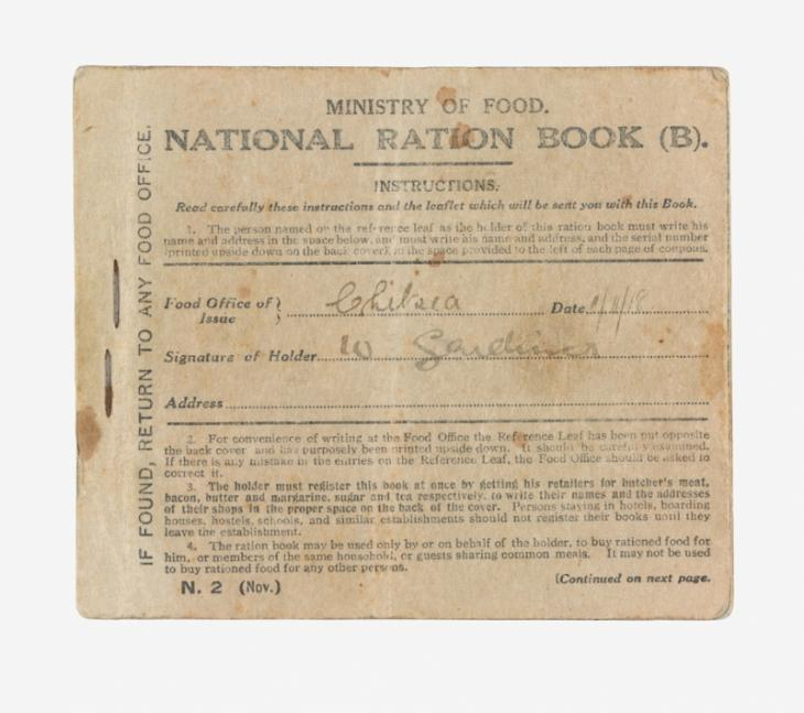 The front cover of the ration book, showing the holder's name and signature.