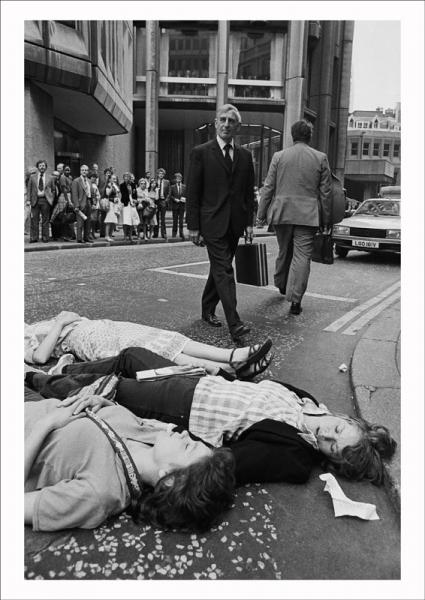 Greenham Common protesters stage a 'Die-in' outside the Stock Exchange during the morning rush hour in the City of London, 1982. Image © Edward Barber.