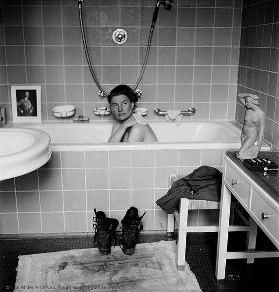 Lee Miller in Hitler's bathtub, Hitler's apartment, Munich, Germany 1945. By Lee Miller with David E. Scherman © Lee Miller Archives, England 2015. All rights reserved.