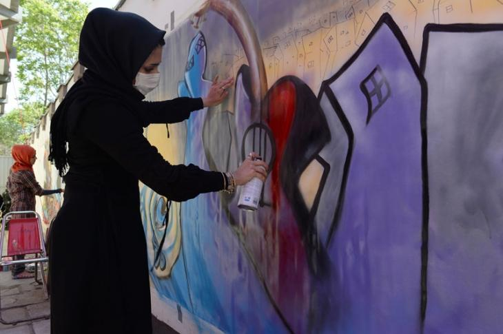 Afghan's first female graffiti artist's distinctive work is enlarged and displayed outisde IWM North.